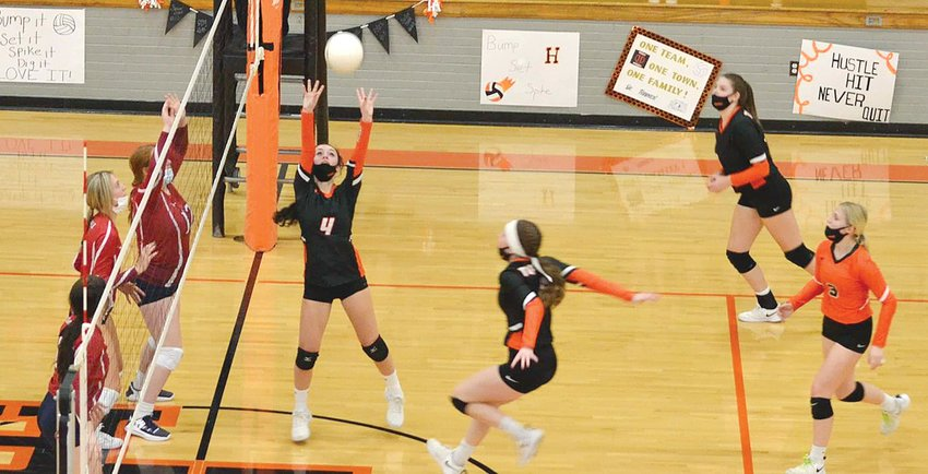 Hillsboro senior Jordan Jacobs sets up classmate Haley Major for a kill during the Toppers' two-game win over Carlinville on senior night, Monday, April 5.