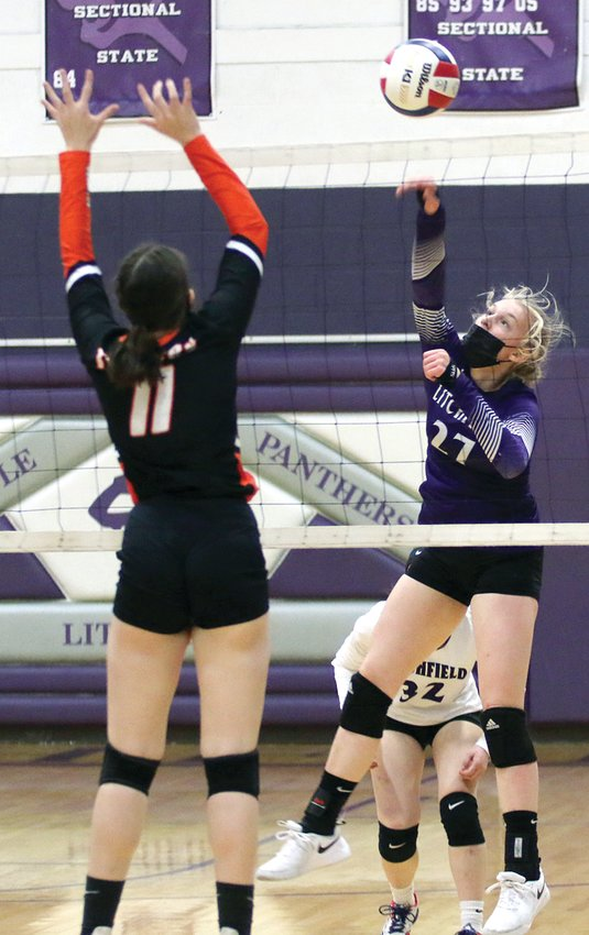 Litchfield freshman Annika Rhodes tries to slip a hit past the block of Hillsboro's Alayna McCario (#11) during the rivalry showdown on Thursday, April 8. Rhodes and the Panthers would win game one, 25-22, but McCario's Toppers got the win with back-to-back 25-20, 25-19 victories.