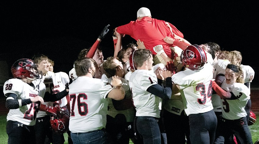 Nokomis football coach Ben Tarter showed that he still had some hops as the Redskins celebrated their 54-0 win over Red Bud on Friday, April 23. The victory secured a conference championship in the small school division of the Cahokia Conference for the Redskins as they finished the season with a perfect 6-0 record.