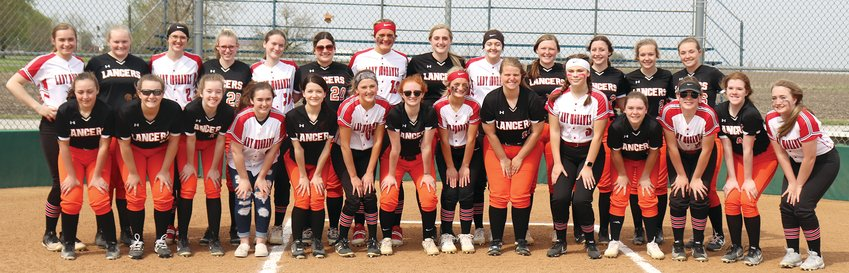 Rivals this year, but teammates in 2022, the Lincolnwood and Morrisonville High School softball teams paused before their game on Tuesday, April 27, in Raymond for a combined team photo as the two schools join forces in an all-sports co-op at the junior high and high school levels starting next season. In front, from the left are Kylie Neisler, Paige Rainwater, Justine Seelbach, Lauren Tapia, Shelby Hattenbach, Ashley Walton, Sidney Glick, Jhia Walker, Sophie Rainwater, Allie Walter, Taryn Millburg, Kirsten Osterholt, Amanda Seelbach and Kylie Clark. In the back row are Whitney Lipe, JoBeth Matli, Isabella Tryon, Chelsie Anderson, Sarah Williams, Desi Pitchford, Alaina Deal, Katelyn Payne, Caitlin Clarke, Brittany Slightom, Cassie Krager, Avery Pope and Marisa Webb.