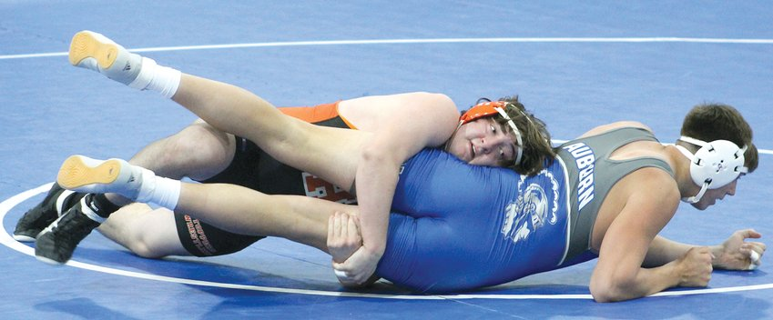 Hillsboro senior Marshall Hughes, shown here during his match with Grant Dobson of Auburn on April 29, is off to a strong start for the Toppers. Four matches into the 2021 season, Hughes is 4-0, with all four matches ending by fall.