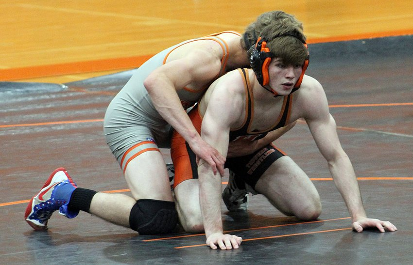 Hillsboro's Andrew Law waits for the whistle during his match with Lance Belshaw of Illini West during the Toppers' meet in Beardstown. Law would unfortunately suffer a season-ending injury in the match, but his Coach Garrett Young hopes he will be able to continue to contribute as a team leader off the mat.