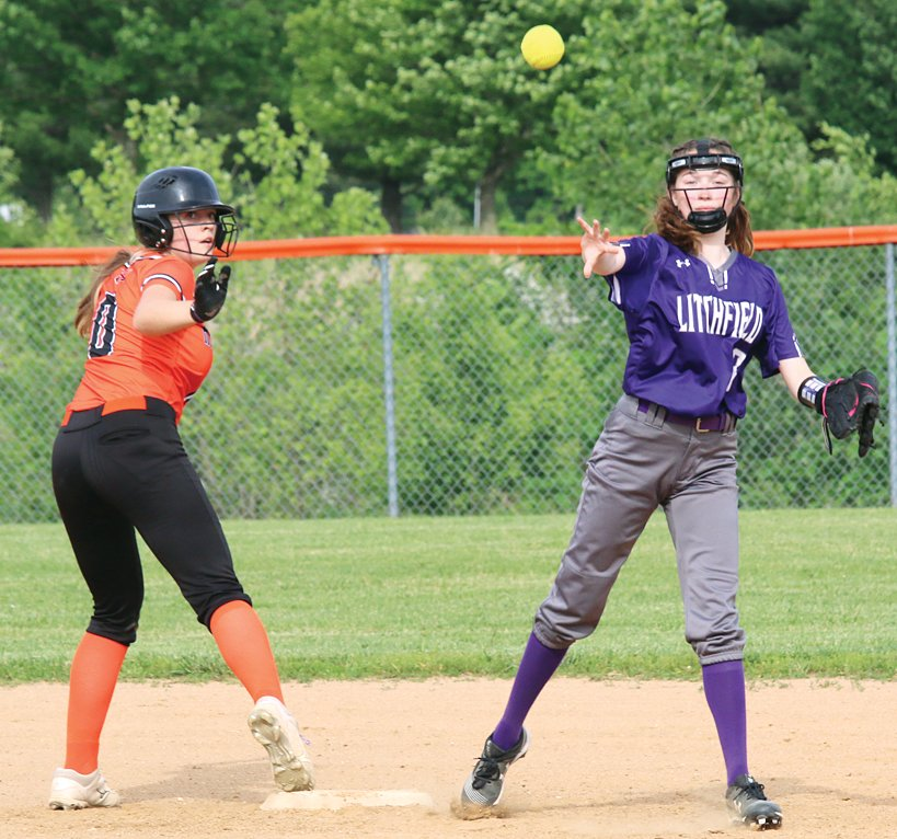After Hillsboro's Sophia Blankenship (right) was able to avoid the tag at second, Litchfield infielder Libby Lamb throws over to first to try her luck there during the match-up between the Panthers and Toppers on Monday, May 24. The game would be close through three innings, before Hillsboro scored seven in the fourth and fifth to come away with a 10-0 victory on their home field.