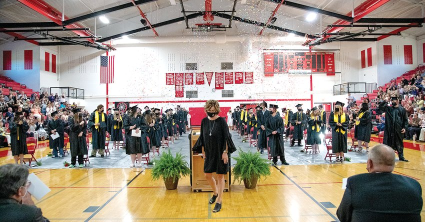 Nokomis High School Principal Rachelle McDowell steps away from the podium as new graduates celebrate following this year's commencement program on Saturday evening, May 29.