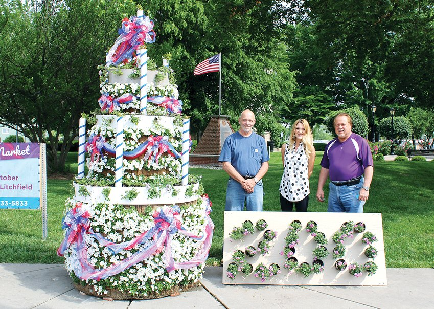 Pictured above with the Bicentennial birthday cake, from the left, are Alderman Dave Hollo, Alderwoman Cassidy Paine and Mayor Steve Dougherty.