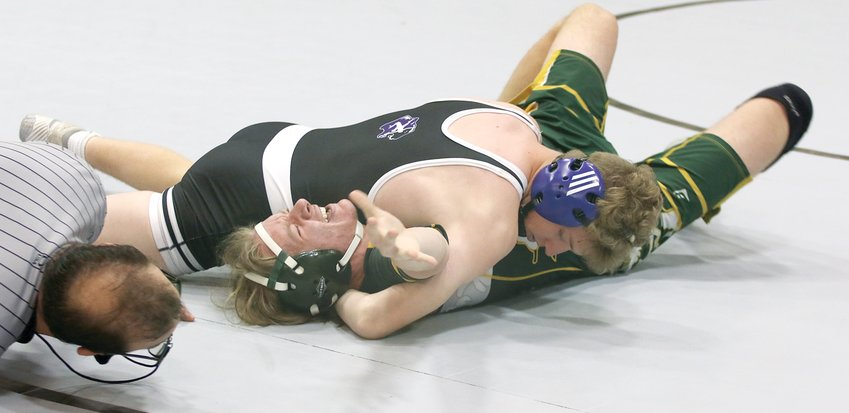 Metro-East Lutheran wrestler Caiden Downs struggles to break free from the grasp of Litchfield senior Aaron Roach during their match on Saturday, June 5, in Litchfield. Roach would earn the pin seconds later, one of three wins by the 145-pounder at the Purple Panthers' final regular season match.
