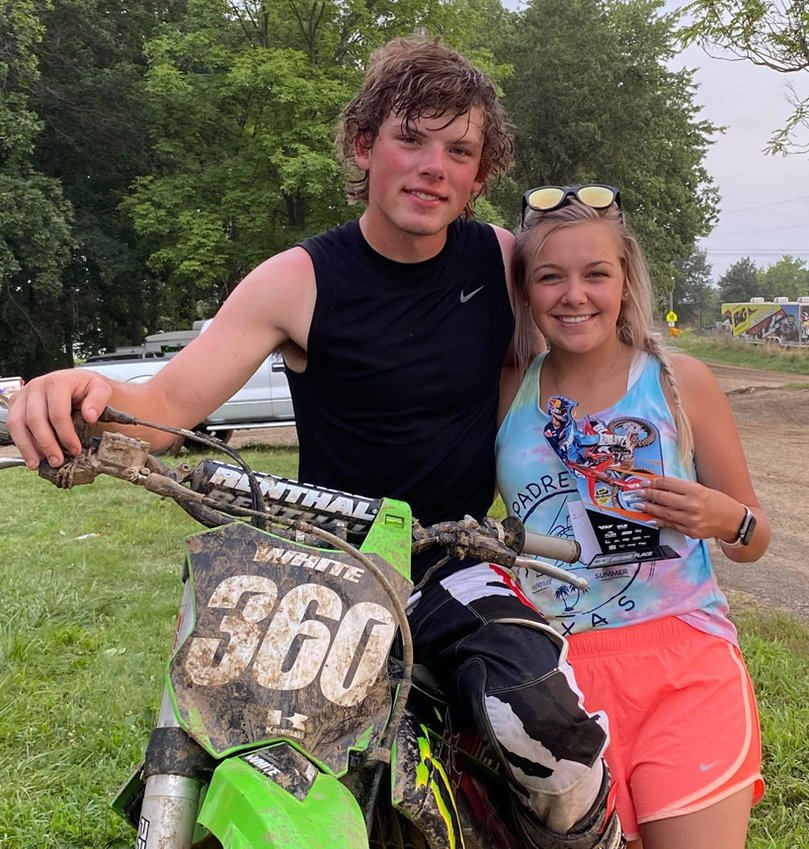 Ty White and Macey Blevins celebrate White's win in the Open Beginner class at the Fly Racing Showdown Series at Lincoln Trail Motorsports in Casey on Sunday, July 25.