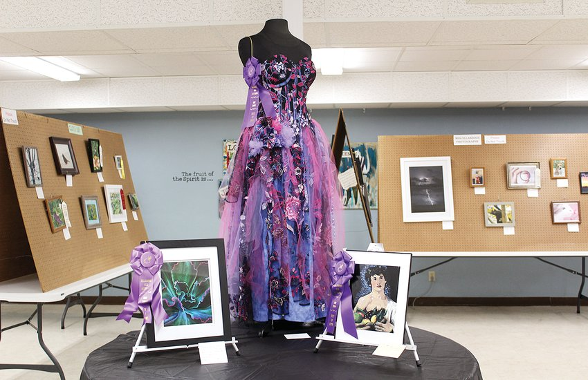 """The work of three local artists took Best of Show awards for pieces exhibited in the 2021 Old Settlers Art Show. From the left, is Maia Moranville's photograph """"Electric Foilage,""""Raven Lawson's """"Wedding Dress"""" in 3-D Crafts and Michelle Weitekamp's painting """"Study of Boy with Basket of Fruit."""""""