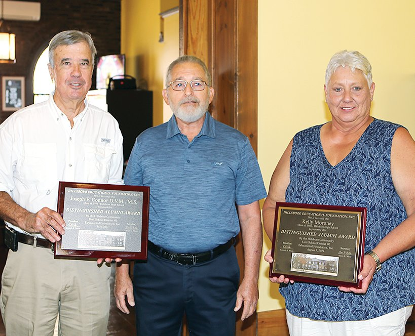 With Hillsboro Education Foundation President Gene White (center) are Distinguished Alumni Award winners Dr. Joseph Connor (left) and Kelly Moroney (right).