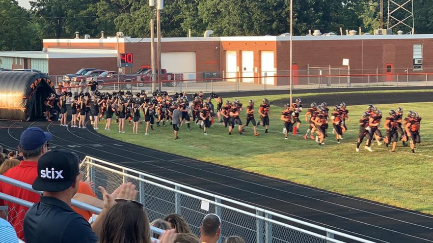 Welcomed by the Hillsboro High School cheerleaders, the 2021 edition of the HHS football team stormed through the tunnel on Friday, Aug. 20, for the annual scrimmage at Sawyer Field. The Toppers hit the gridiron for real on Friday, Aug. 27, in Greenville.