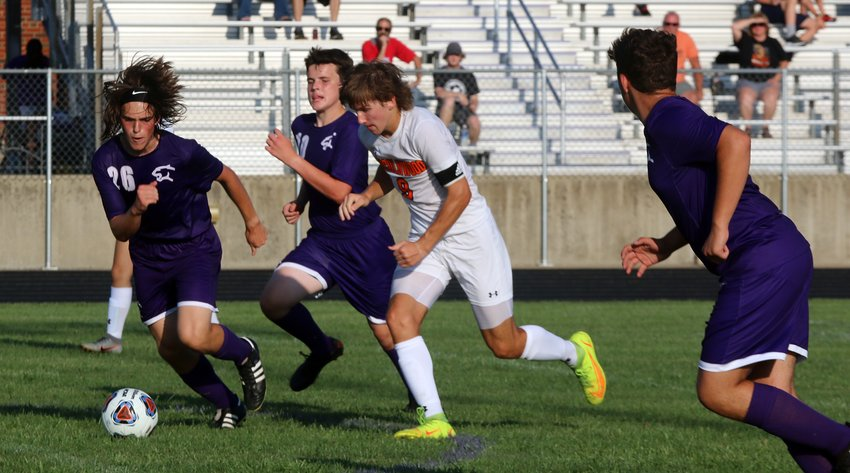 Litchfield's Leo Page (#26) and Anthony Bader (#10) try to track down the ball and Lincolnwood's Elijah Aumann during the Purple Panthers' opening game on Aug. 24. Aumann would break free and score the first of his four goals in Lincolnwood's 6-1 win.