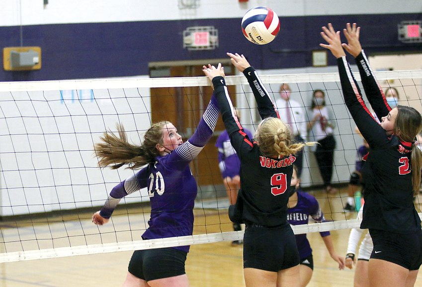 Litchfield's Blair Johnson (#20) tries to tip a shot over the outstretched hands of Nokomis' Addison Dangbar (#9) and Audrey Sabol (#24) during their Montgomery County match-up on Thursday, Aug. 26. The Redskins would carry the momentum from a 25-15 win in game one into game two as they defeated the Panthers 25-16 to pick up the sweep.