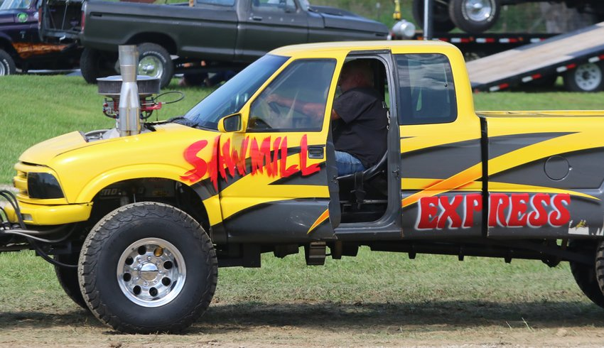 Chuck Feldman's Sawmill Express took first in the Modified class at the Montgomery County Fairgrounds on Sunday, Aug. 22, pulling 347.79 feet to beat out second place Steve Hummert. More than 100 entries hooked up to the sled at the truck and tractor pulls, which had been rained out twice before.
