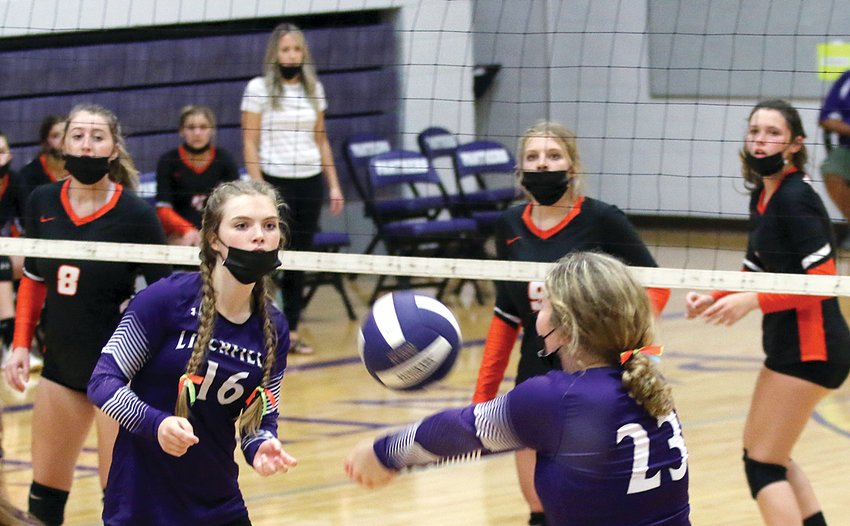 With Hillsboro's Adyson McCammack (#8), Sophia Blankenship (#9) and Emilee Roemelin waiting on the other side, Litchfield's Ashley Hickerson looks to set up fellow senior Taylor Brakenhoff in game two against the Hiltoppers on Thursday, Sept. 2. After taking game one 25-16, Litchfield carried the momentum on to game two, winning 25-21 to end a 14-game losing streak against Hillsboro.