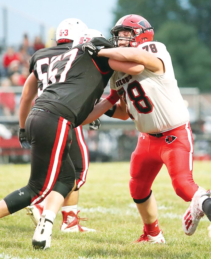 Nokomis' Wyatt Dooley (#78) and Central A&M's Ethan Sunderland (#57) tussle at the line of scrimmage as Dooley tries to make his way to the ball carrier in Friday's match-up in Assumption. The Raiders would live up to their number one ranking with a 45-14 win over the Redskins, their first loss in eight games.