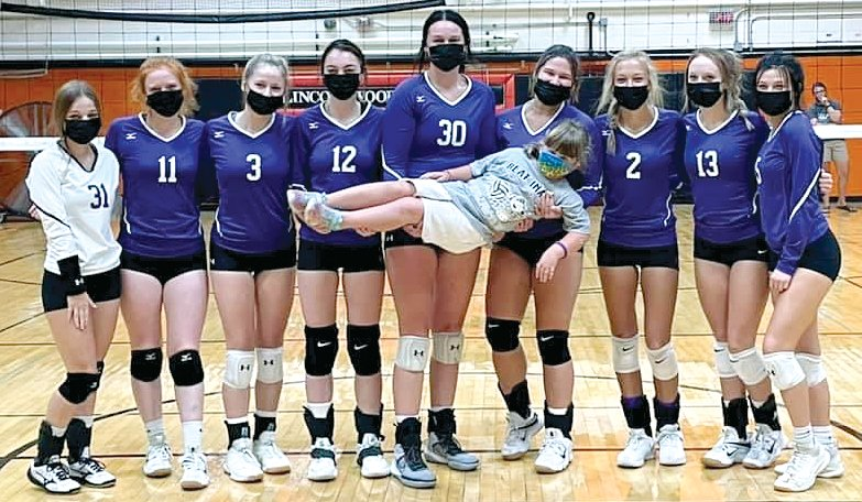 The Lincolnwood-Morrisonville volleyball team took time for a picture with Charlotte Herschelman (held in front), the sister of the late Grace Herschelman, before their game in Saturday's Grace-Filled Tourney. Pictured from the left are Jasmine Vickery, Sidney Glick, Tessa Funderburk, Jazmin Seaton-Hobson, Hailee Belsher, Desi Pitchford, Avery Pope, Haelee Damm and Madyson Bockewitz.