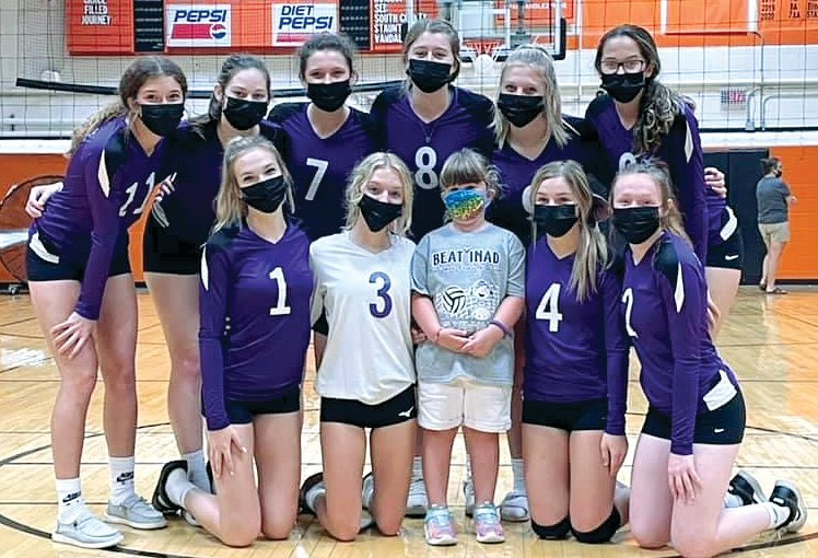 The Hillsboro High School volleyball team took time for a picture with Charlotte Herschelman, the sister of the late Grace Herschelman, before their game in Saturday's Grace-Filled Tourney. Pictured in front, from the left, are Layne Rupert, Isabella White, Charlotte Herschelman, Kinley Richardson and Abbigail Schreiber. In the back row are Tatum Christian, Alayna McCario, Emilee Roemelin, Adyson McCammack, Sophia Blankenship and Kenadie Carlock