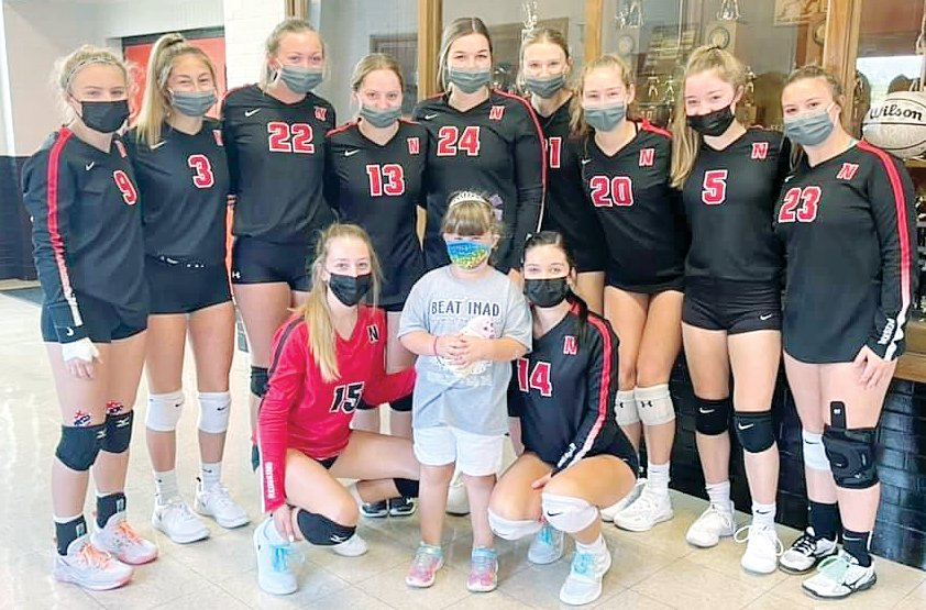 The Nokomis High School volleyball team took time for a picture with Charlotte Herschelman, the sister of the late Grace Herschelman, before their game in Saturday's Grace-Filled Tourney. Pictured in front, from the left, are Emily Cress, Charlotte Herschelman and Presley Lamb. In the back are Addison Dangbar, Hailey Engelman, Skylar Stewart, Presley Mehochko, Audrey Sabol, Reaghan Jonas, Rean Ward, Natalie Engelman and Carley King.