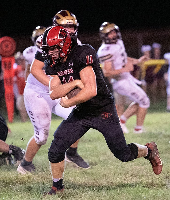 Nokomis' Jake Johnson rushed for two touchdowns and caught a third in the Redskins come-from-behind 24-20 win over East Alton-Wood River on Friday, Sept. 10, in Nokomis.