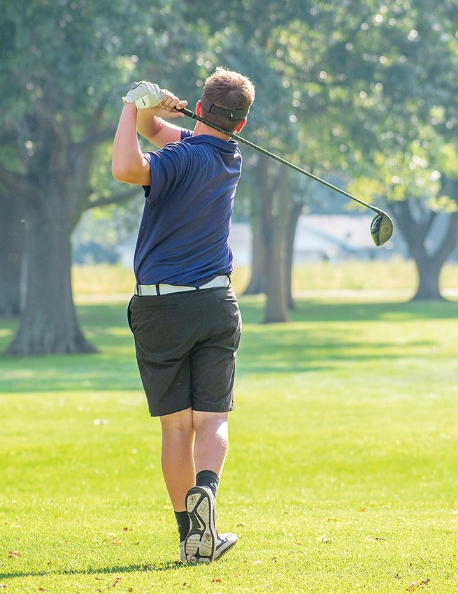 Litchfield's Ian Otto watches his tee shot on senior night at the Litchfield Country Club on Sept. 13. Otto shot a 42 to help Litchfield pick up a win over Carlinville in the match.