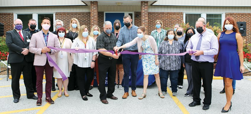With staff, partners, and the Litchfield Chamber of Commerce in support, Kent Tarro, Pastor Jon Magnuson, and Dr. Carissa van den Berk-Clark cut the ribbon during a ceremony at St. Francis Way Clinic Wednesday morning, Sept. 15, in Litchfield.