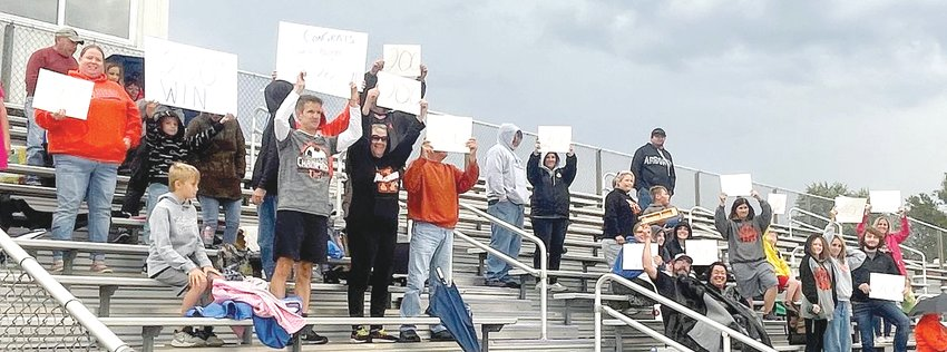 Fans of the Hillsboro High School boys soccer team came prepared for history if the opportunity arose on Tuesday, Sept. 21, as Topper Head Coach Jason Burke entered the game with 199 career wins. Those brave enough to weather the dreary conditions in Litchfield on Tuesday greeted Coach Burke with signs signifying his latest accomplishment after the game as he picked up win number 200 with a 6-0 victory over the Purple Panthers.