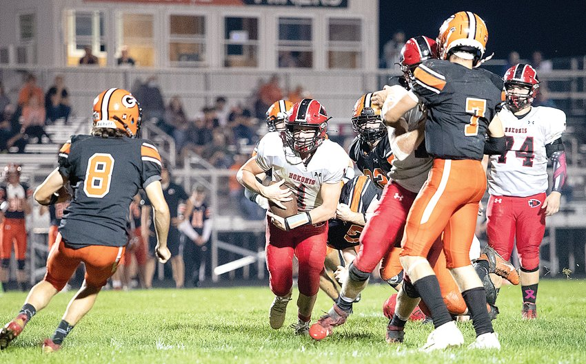 The Nokomis offensive line provided plenty of room for the Redskin backs to run, including quarterback Connor Overby, who had 47 of Nokomis 382 rushing yards in Nokomis' 35-12 win in Gillespie on Oct. 8.