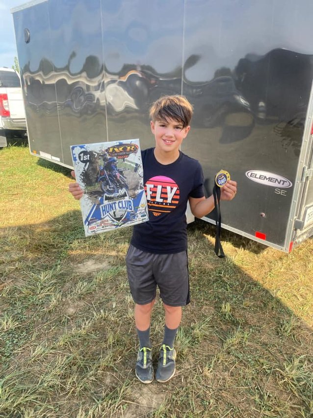 Walshville's Travis Lentz shows off his hardware after winning round nine of the IXCR Cross Country Series in Madison, IN, on Sept. 19. Lentz also won round 10 of the series and currently sits first in the points.