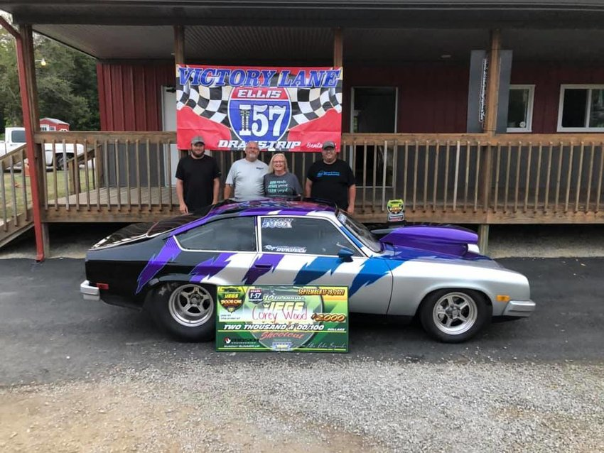 Pictured above, from the left, are Dustin Bryant, Phil and Sharon Bryant and Corey Wood, along with the Chevrolet Vega he piloted to a second place finish at the Summer Door Car Shootout, owned by Roger and Pam Burdell.