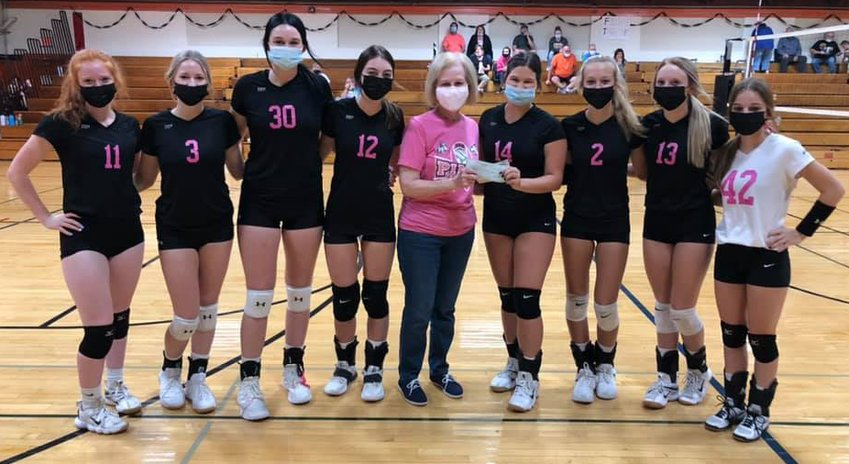 It was a chance to celebrate breast cancer survivors and the future of Lincolnwood volleyball on Thursday, Oct. 8, as the Lancers hosted the youngsters from their Dig For A Cure clinic prior to their game against Calvary in Raymond. The team also donated more than $900 to the Montgomery County Breast Cancer Support group from the proceeds of the clinic and other fundraisers for the cause. Above, from the left, are Sidney Glick, Tessa Funderburk, Hailee Belsher, Jazmin Seaton-Hobson, Linda Brown, Desi Pitchford, Avery Pope, Haelee Damm and Jasmine Vickery.
