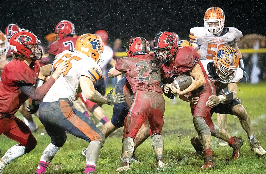 Through the pouring rain, Nokomis' Matthew Hill drives forward for a few extra yards during the Redskins' week eight contest against Pana on Oct. 15. Hill and the Redskins put up a fight against the undefeated Panthers before falling 17-0 on the friendly, but sloppy, confines of Redskin Field.
