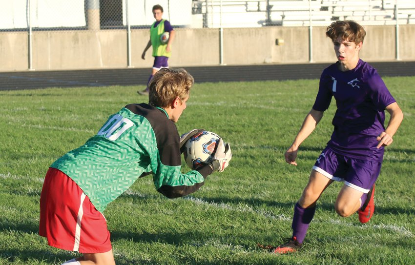 The Panthers' pressure on the Effingham goal, like that shown by Ean Davis (right), paid off big for Litchfield on Monday, Oct. 18, as they scored three times in the first half en route to a 4-2 win over the Flaming Hearts in the regional quarterfinal at Litchfield. The win moved Litchfield into the regional semifinal against Civic Memorial, the regional host and second seed in the subsectional.