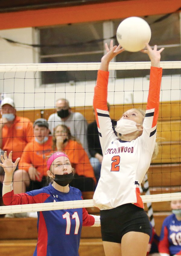 Lincolnwood's Avery Pope sets up one of the Lancers 26 kills on Monday, Oct. 18, as Lincolnwood made short work of Pawnee, beating the Indians 25-7, 25-14.
