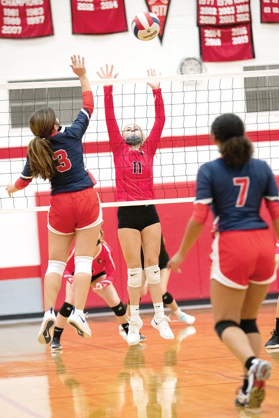Nokomis' Hailey Engelman goes up for a block against Calvary during the Redskins 25-21, 25-18 win over the Saints. Engelman led the team in service points, kills, digs and was second in assists in the win, Nokomis' 10th of the season.