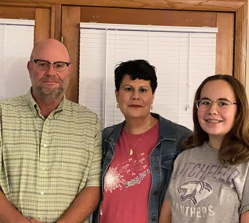 Kim Reynolds of Litchfield, center, was diagnosed with breast cancer in December 2019. She said her family, including husband, Steve, and daughter, Maggie, helped her persevere.