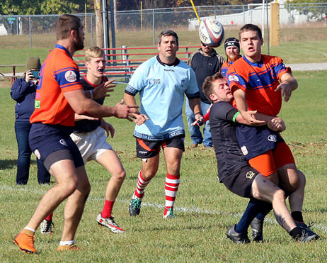 "Gavin Twitty (right) passes to Nick ""Little Nick"" Sattler during the Mercenaries match with the Belleville Rowdies at Mercfest in Hillsboro on Saturday, Oct. 27. Twitty, a former standout football player and wrestler for Hillsboro High School, is one of several Mercenaries with ties to Montgomery and Macoupin counties."