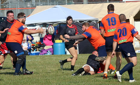 "Nick ""Big Nick"" Pierce-Cramer (left) prepares to take a pass from Lyle Polus during the Mercenaries match with the Belleville Rowdies at Mercfest on Saturday, Oct. 27, in Hillsboro. Polus' stepfather also played rugby, for the predecessor of the current team, the Macoupin County Mercenaries."