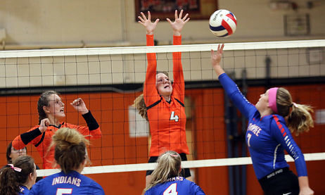 Lincolnwood's Maddie Krager (#4) tries to get a hand on a tip by Pawnee's Paige Langheim during game one of the Lincolnwood Regional semifinal in Raymond on Tuesday, Oct. 23. Pawnee would survive to advance to Thursday's regional championship by virtue of their 29-27, 25-21 victory over the Lady Lancers.
