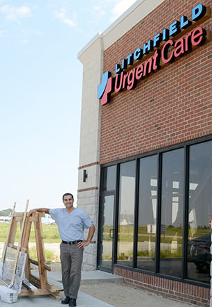 Dr. Paul Toofan stands outside the new Litchfield Urgent Care clinic, located on Thunderbird Drive in Litchfield. The clinic is expected to open this fall.