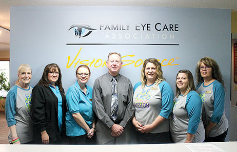 567a2bcad58 Staff members of Family Eye Care in Hillsboro help to celebrate Dr. Doug  Johnson s