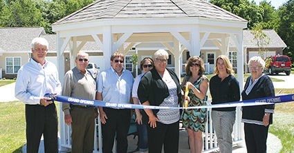 Cutting the ribbon Wednesday at Bluff Street Senior Homes in Hillsboro, from the left are Mike Niehaus of Windsor Development Group, MCHA board member Ken Durbin, MCHA board Chairman Dan Hough, MCHA board member Deanne Jones, MCHA CEO Kelly Moroney, IDHA Executive Director Audra Hamernik, MCHA board member Amy Patton and MCHA board member Joyce Matthews.