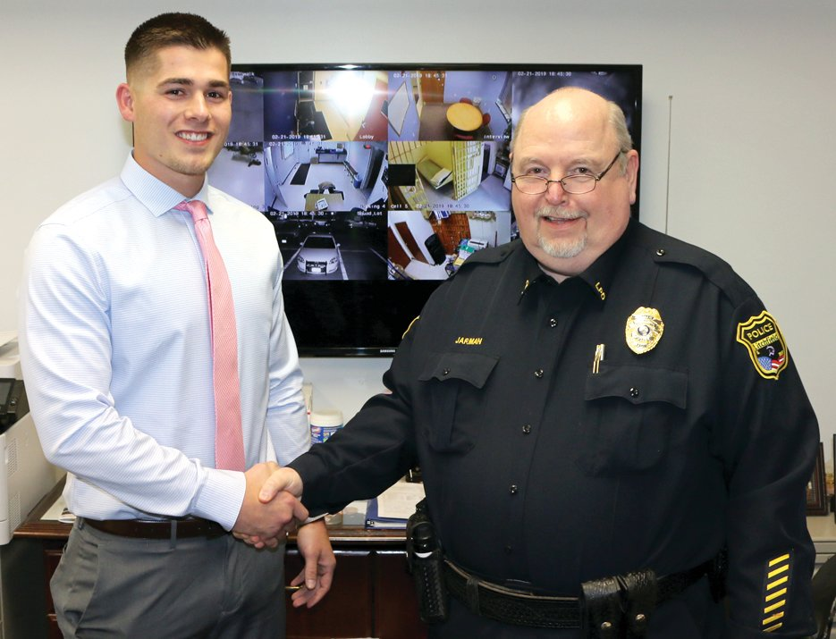 Litchfield Police Chief Lee Jarman welcomes the department's newest officer, Tylor McBride, to the force during the Litchfield City Council meeting on Thursday, Feb. 21. McBride, a graduate of Staunton High School and SIU-Edwardsville, will be attending the Southwestern Illinois College Police Academy starting on March 7.