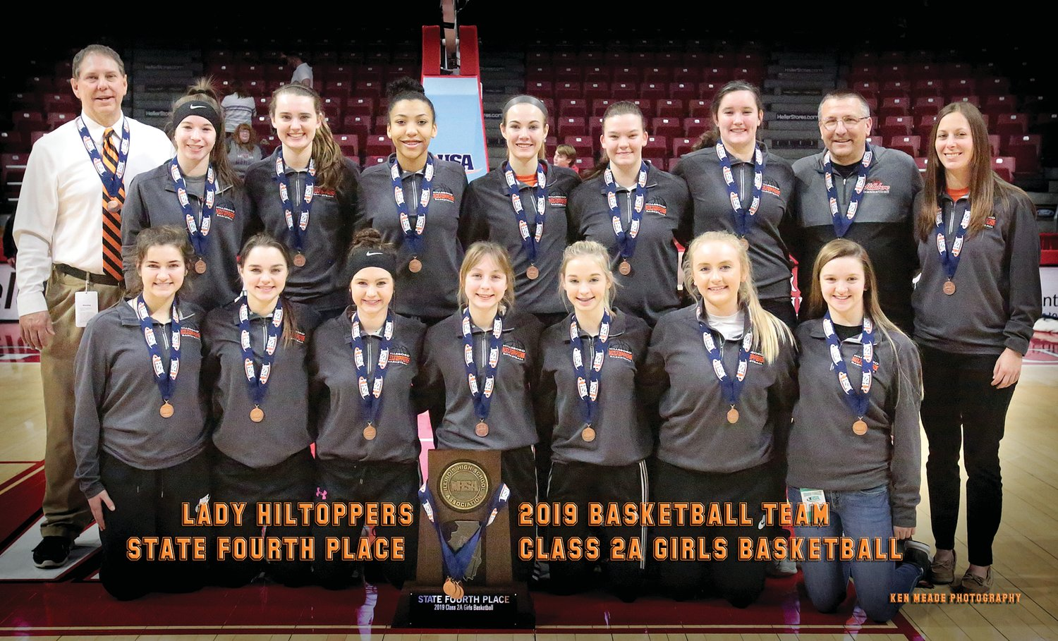 Members of the Hillsboro High School girls basketball team pose with their fourth place trophy at the IHSA State Tournament at Redbird Arena in Normal after the championship game on Feb. 23. In front, from the left, are Emily Reynolds, Jade Scroggins, Sheridan Lyerla, Vanessa Compton, Maddy Rupert, Claire Tester and manager Glory Wilson. In the back row are Head Coach Bret Tuetken, Haley Major, Sammi Matoush, Nikya Harston, Kylie Meier, Aubry Rupert, Maci Blankenship, Assistant Coach Bob Allen and Assistant Coach Paige Cullison.