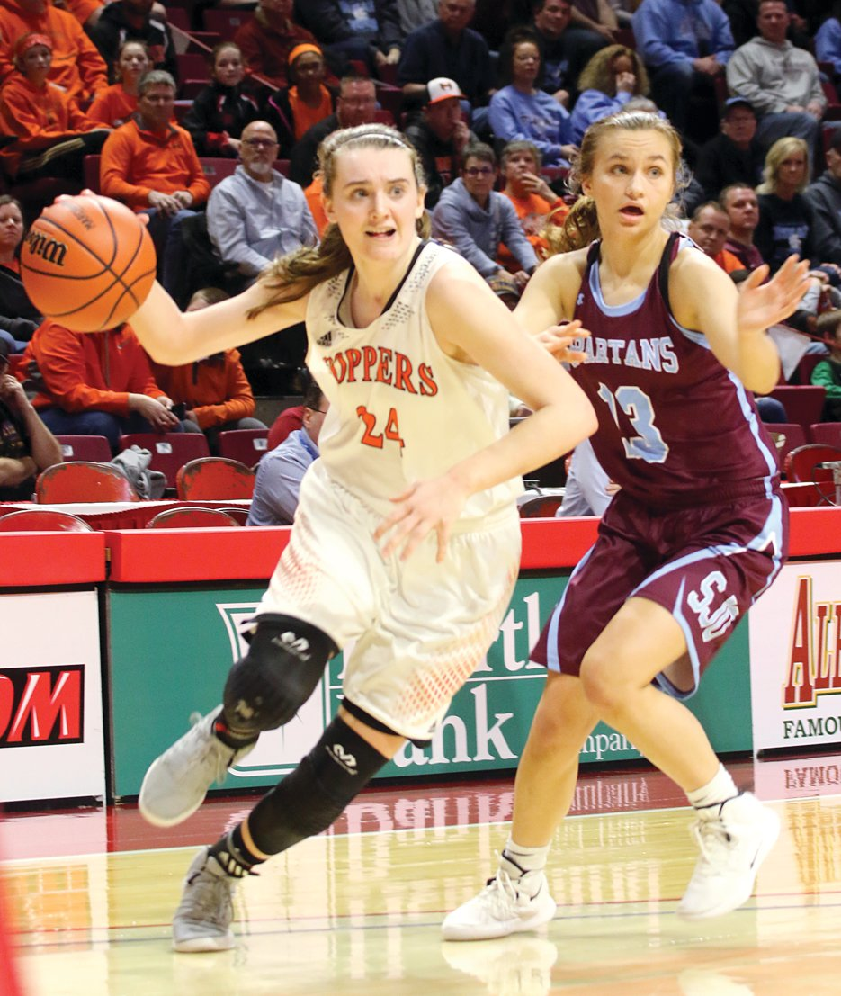 Hillsboro's all-time leading scorer, Sammi Matoush, drives past Peyton Crowe of St. Joseph-Ogden during the third place game at the IHSA State Tournament at Redbird Arena in Normal on Feb.  23.