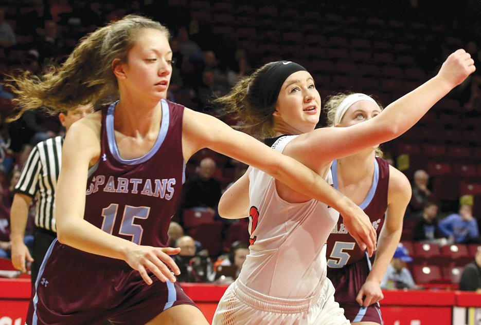 Hillsboro's Sheridan Lyerla battles for rebounding position with Taylor Barnes of St. Joseph-Ogden during the third place game at the IHSA State Tournament at Redbird Arena in Normal on Feb.  23.