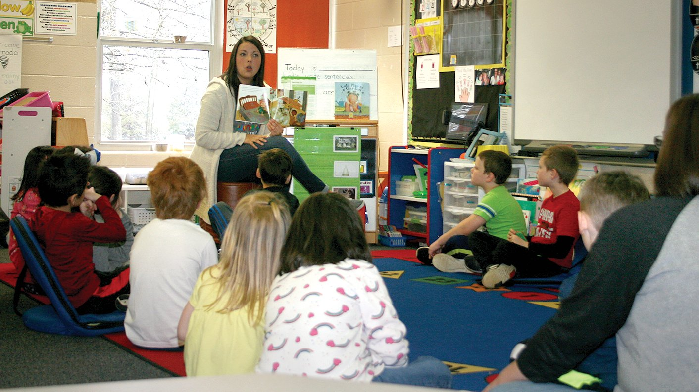 Mid-State Behavior and Autism Specialist Emma Reichert taught interactive lessons on autism acceptance at Beckemeyer Elementary School on Friday, April 5. Above, Reichart reads to the kindergarten students in Mrs. Alycia Morford's class.