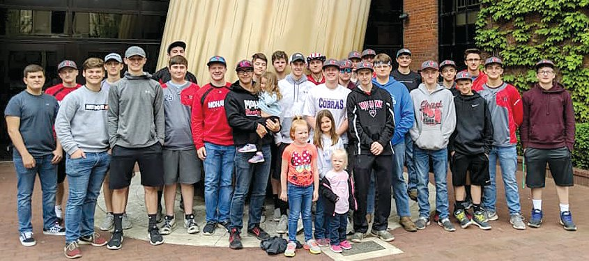 Each year the Morrisonville/Lincolnwood baseball team takes a spring trip to catch a game and build some team camaraderie, a tradition that started well before the Lancers began the co-op with the Mohawks. This year, the team went to Louisville for a Louisville Bats game and a visit to the Louisville Slugger Museum. Pictured with the team are Kendyl and Macie Ferrill, daughters of Coach Mark Ferrill, and Carolyn and Addison Stone, daughters of Coach Josh Stone.