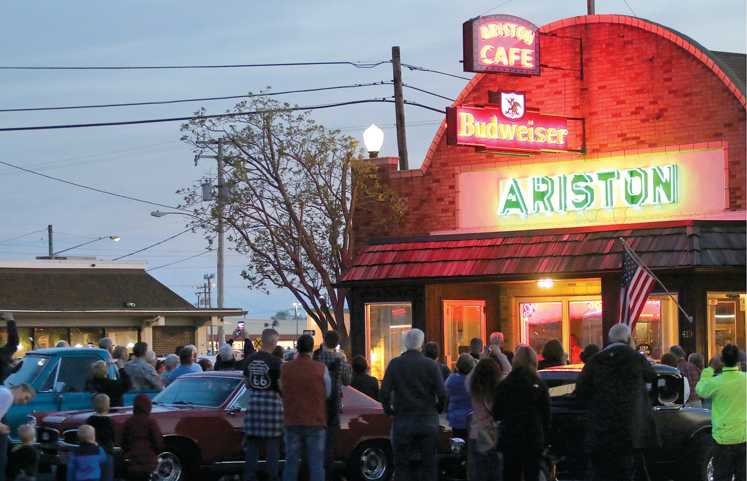 Local community members and Route 66 enthusiasts gathered at the historic Ariston Cafe in Litchfield on Saturday evening, May 4, to celebrate the relighting of the neon signs atop the restaurant, as well as accents in the front window. The work was completed by the Neon Preservation Committee of the Route 66 Association of Missouri.