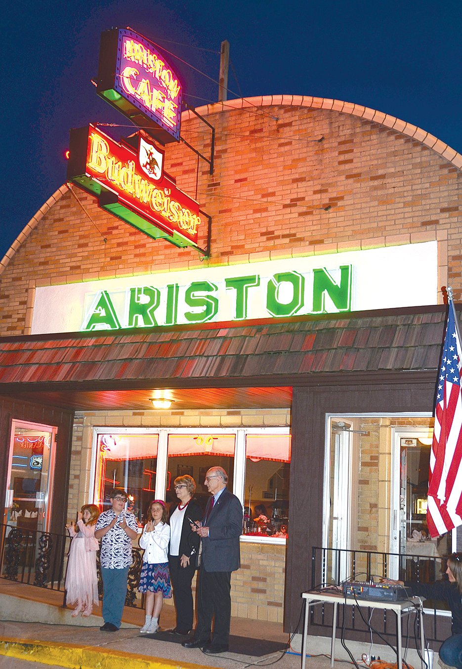Nick and Demi Adam, longtime former owners of the Ariston Cafe, celebrated the special relighting with members of their family. They are pictured above with their grandchildren, Maria Adam, Nicholas Adam and Leah Adam.