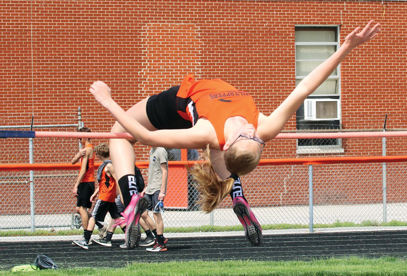 "Hillsboro freshman Kaci Papin cleared 5'5"" to tie the school record and win the high jump in the South Central Conference Meet on Monday, May 6, at Hillsboro. Papin would go on to clear 5'3"" in the high jump in Wednesday's sectional in Springfield, earning a spot at the IHSA State Finals next week."